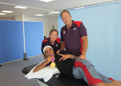 Clive Lathey and the team volunteering with free treatments during the 2012 London Paralympic Games.