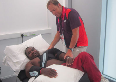 Clive Lathey treating a Paralympic athlete at the London 2012 Paralympic Games.