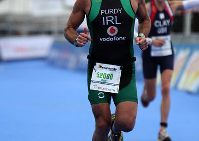 Graeme Purdy, who is a client of The Putney Clinic of Physical Therapy, competing in the PruHealth World Triathlon in London in September 2013, running for Ireland.